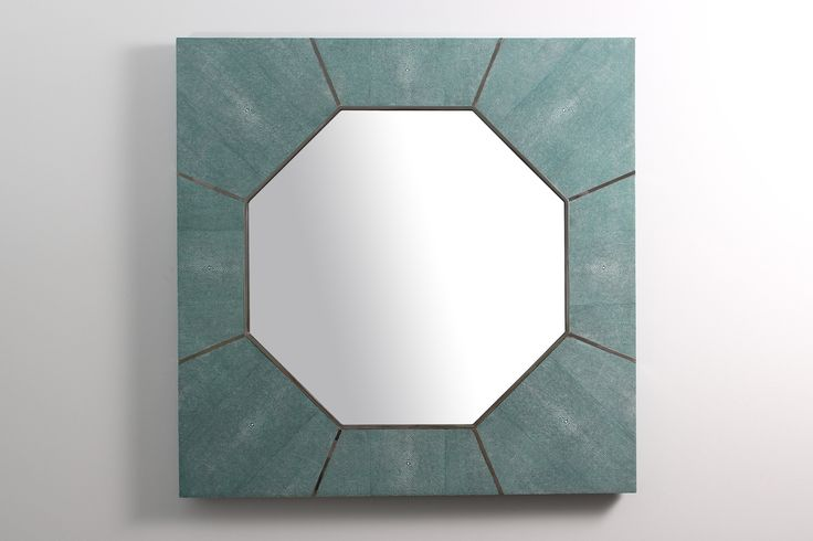 The Keslo wall mirror is a contemporary mirror with echoes of the past. The mirror frame is made in stainless steel with teal designer shagreen giving it an elegant blend of textured leather and polished metal. The hexagon shaped mirror looks stylish in both modern and traditional interiors as a hall mirror, console table mirror or living room mirror.