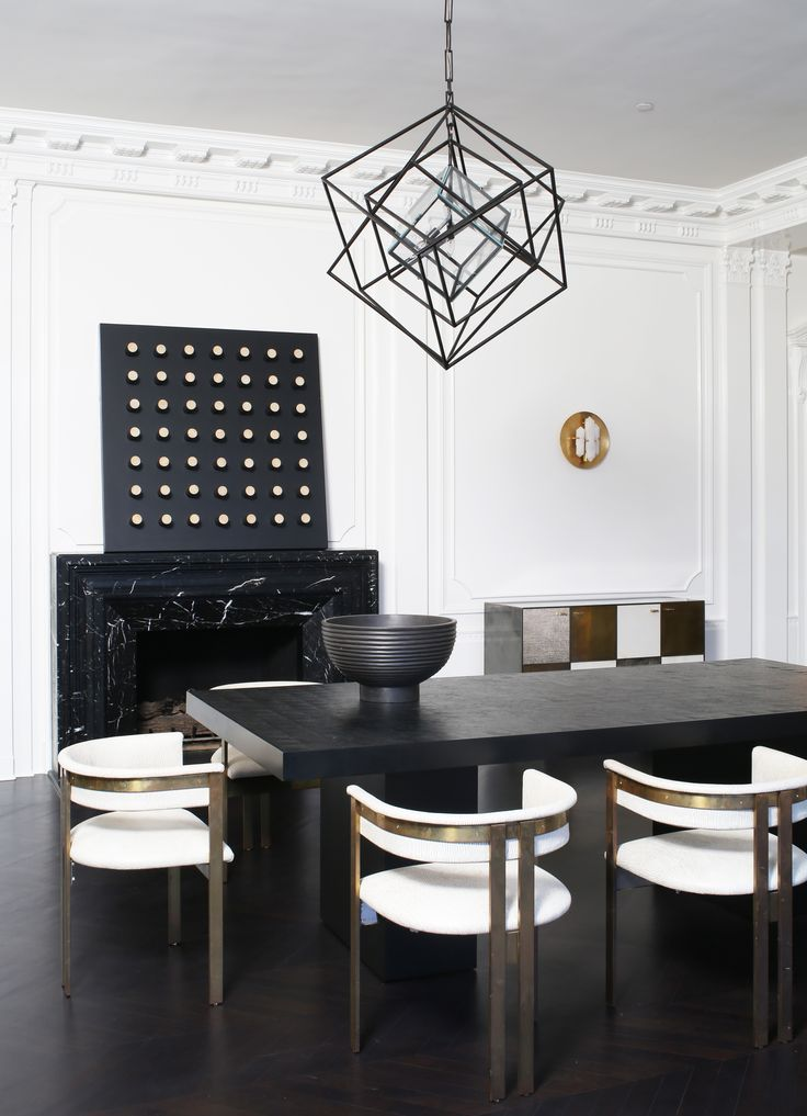 KELLY WEARSTLER   LARGE CUBIST CHANDELIER. The three-dimensional geometric sculptures utilize the interplay between light and shadow. Ideal for large living spaces with high ceilings.