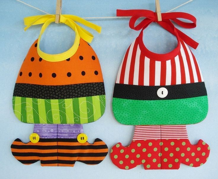 witch and elf baby bibs... lol   sweet...