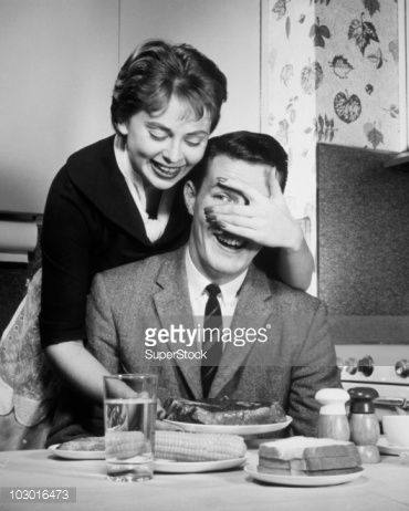Stock Photo : Mid adult woman covering eyes of mid adult man