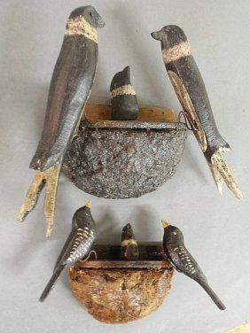 Two Black Forest carved birds-on-nests, largest