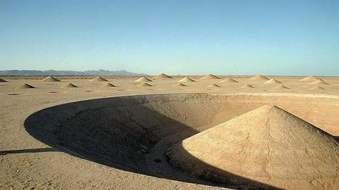 Cones of the Egyptian Desert ~ It looks like a landing strip for extraterrestrial spacecraft, a portal to a parallel universe, or an ancient monument to a benevolent deity. These cones, just a short distance from the shores of the Red Sea, is actually an environmental art installation. And it's been baffling visitors and google earth viewers since it was constructed in March 1997. A team designed and built the enormous 1 million square foot piece of artwork; called Desert Breath