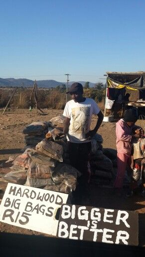 Selling wood in Africa