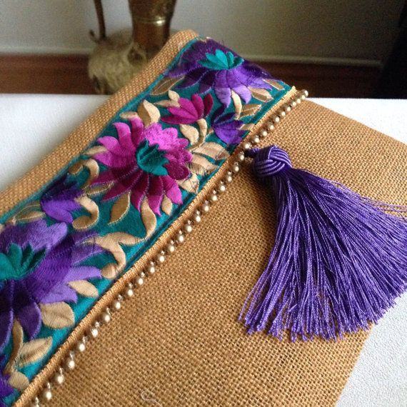 Floral Clutch, Mustard Yellow-purple Clutch Bag, Bohemian Clutch, Ethnic Handbag, Womens Bag, A fashion statement that everyone will swoon over! This floral clutch will bring elegance to your style. It will be chic with jeans or dresses and you may use this clutch bag both day and night. This clutch bag is perfectly handmade with high quality mustard yellow jute fabric. Designed with a silk bohemian embroidery and a tassel. Clutch has a purple silk satin interfacing and a padding inside to…