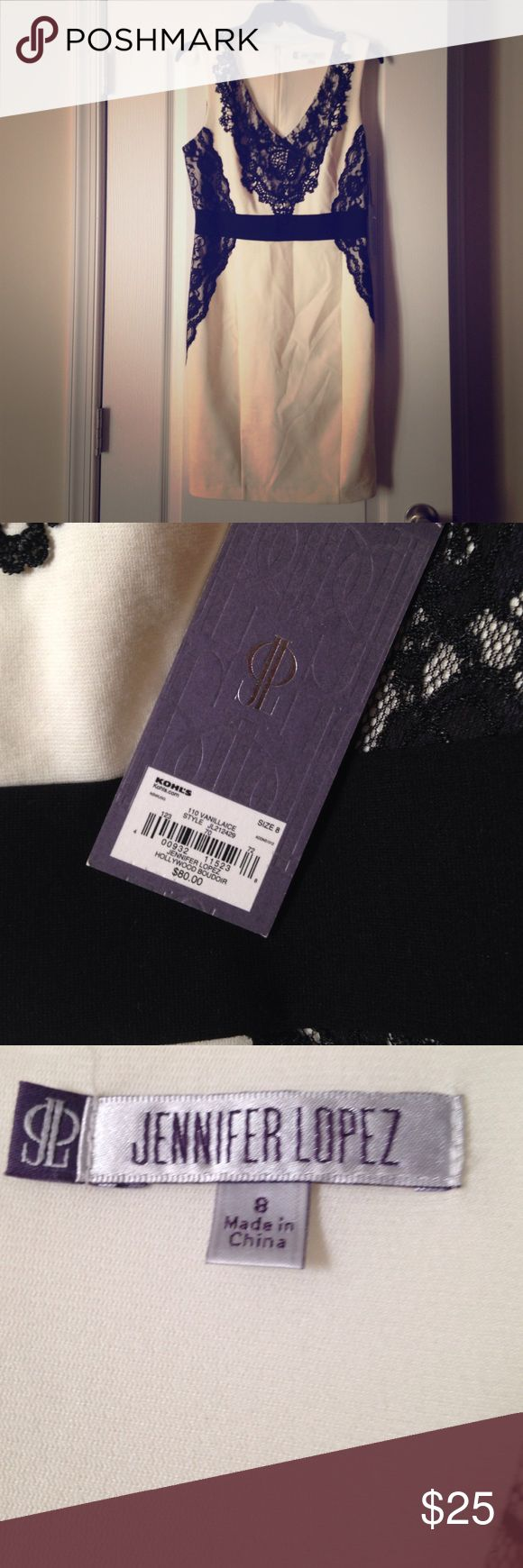 NWT Stunning JLO Professional/ Classy Dress NWT. Beautiful Jennifer Lopez dress. Can it can be worn as a business professional dress or just a night out. It is approximately kneelength. MSRP $80. It has lace appliqué. You can't beat this deal! Check out my other listings for bundle deals! Jennifer Lopez Dresses