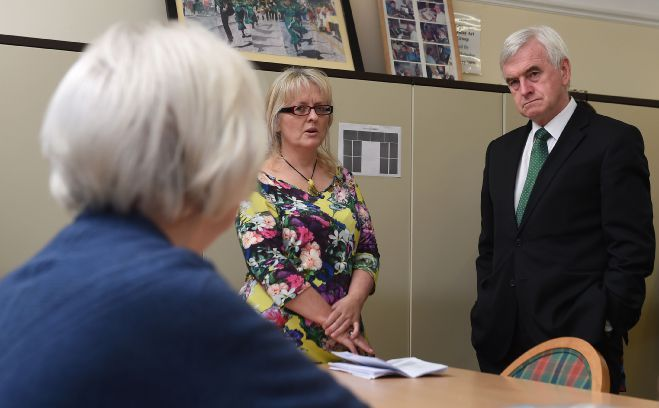 Shadow chancellor John McDonnell listens to pensioner Ann Caswell at the Gilbert Richards Centre in Coventry