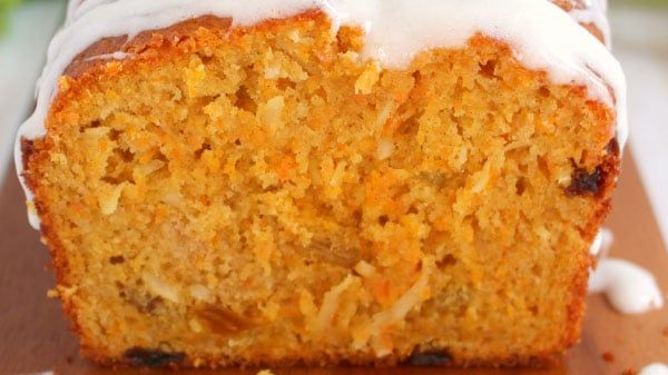 Loaded with coconut, shredded carrots and golden raisins and glazed with a cream cheese icing, a slice of this carrot coconut bread is like having carrot cake for breakfast! Glazed Carrot Coconut Brea
