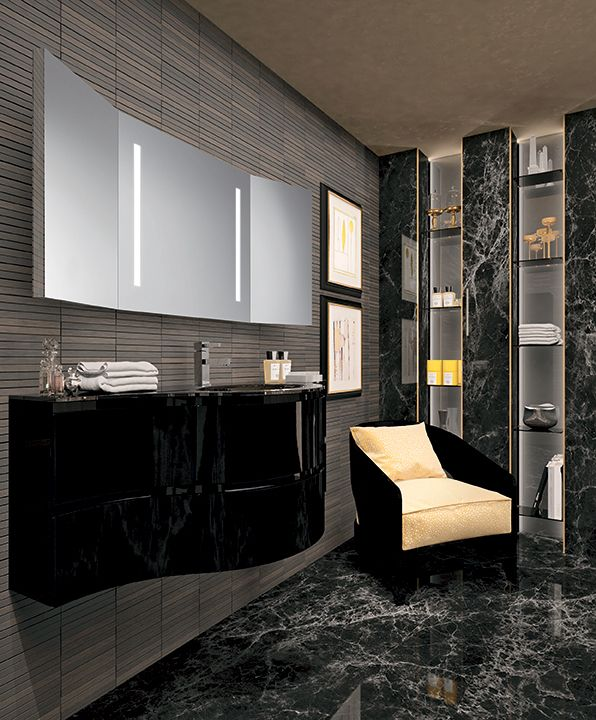 "New ""Esprit"" bathroom furniture collection by Oasis; vanity unit in a polished lacquer finishings; Zoe armchair designed by Massimiliano Raggi for Oasis, in a black version. The mirror comes from the new ""Mirrors"" collection."