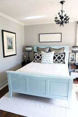 Blue bed with black and white decor