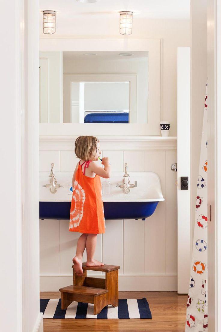 kids bathroom / blue and white metal trough sink / industrial lighting