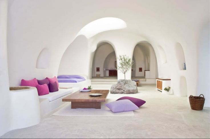 Simple but striking rooms at Perivolas Hotel Oia, Santorini - 300 year old caves now converted into twenty luxurious suites.