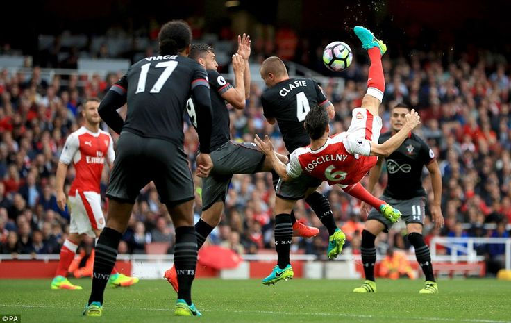 Arsenal 2-1 Southampton: Santi Cazorla nets last minute penalty to rescue three points after Laurent Koscielny had scored with acrobatic overhead kick on his 31st birthday