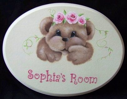 Handpainted and personalised oval name plaque for baby girl, nursery decor, or young girl's bedroom. by colourworx on Etsy