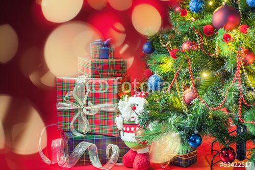 Decorated christmas tree with gift boxes and Santa Clus toy