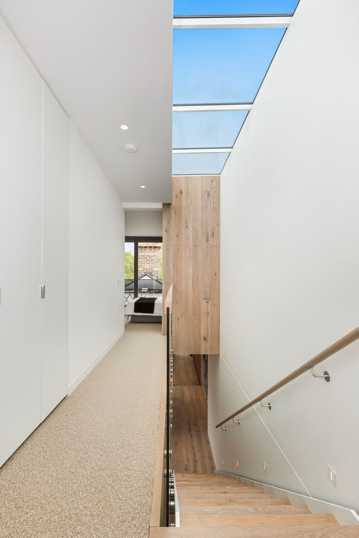 Tongue n Groove Oslo Eterno Piccolo solid oak floorboards used for stairs and feature wall at South Yarra, Victoria . Boards available from http://www.tonguengrooveflooring.com.au