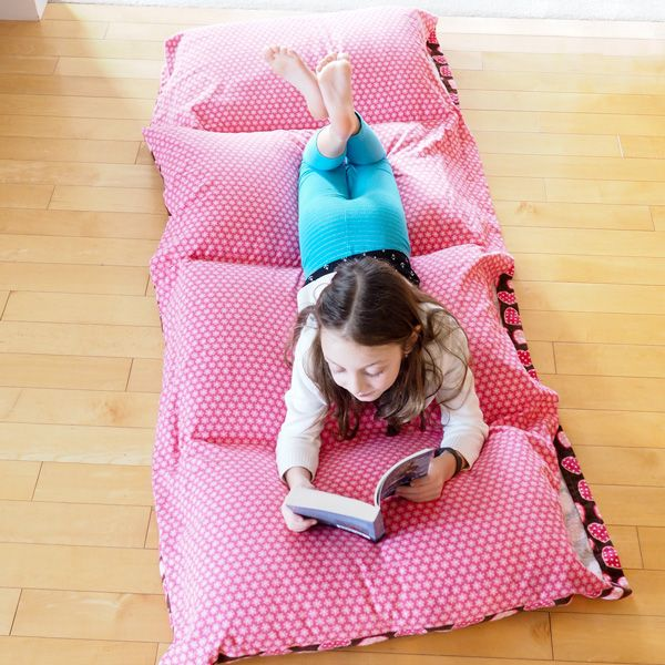 Learn how to make a cozy pillow bed with this quick and easy tutorial – a great beginner sewing project. Perfect for reading, lounging, sleepovers and camping!