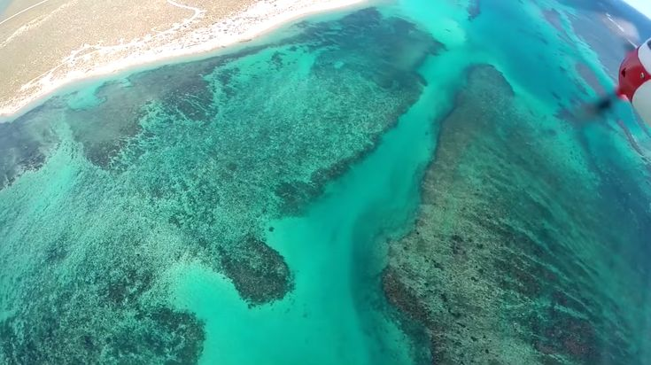 A casual beach side flight of a radio controlled plane goes wrong in the glare from the sun, but the GoPro catches the crash into the water on film, and so much more underwater.