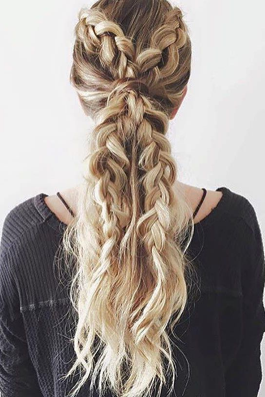 Two braids are better than one! This unique hairstyle is by @thebeautydept <3