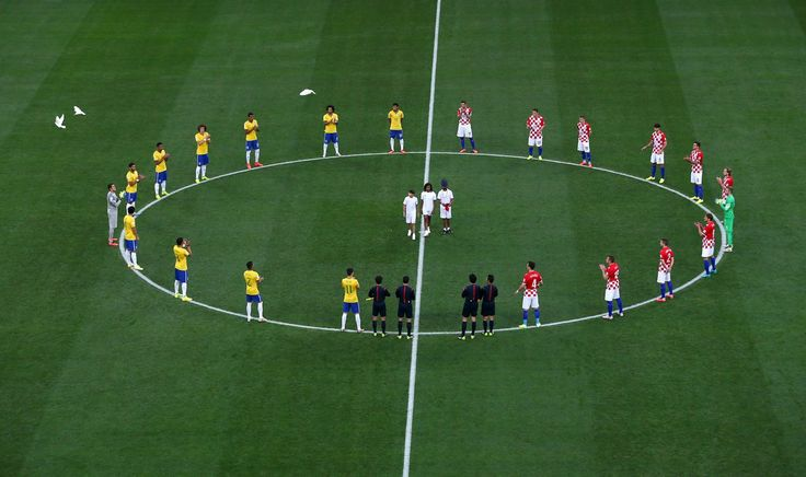 Brazil and Croatia players stand around the center circle as doves are released before the 2014 FIFA World Cup Brazil Group A match between Brazil and Croatia at Arena de Sao Paulo on June 12, 2014 in Sao Paulo, Brazil