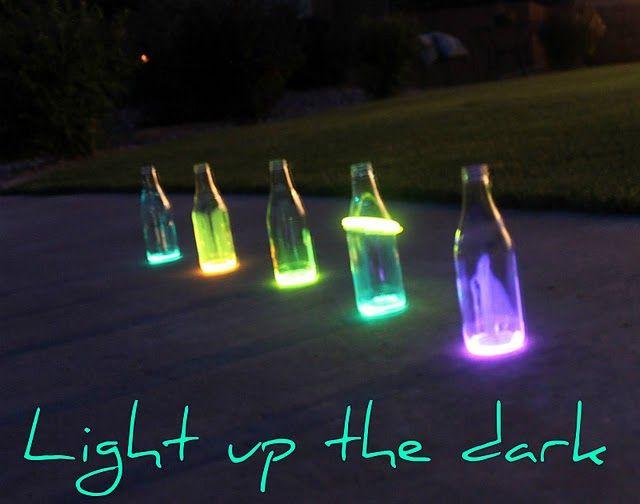 Empty bottles, break open a glow stick, swirl, add a little water or oil for more fun. Easy.