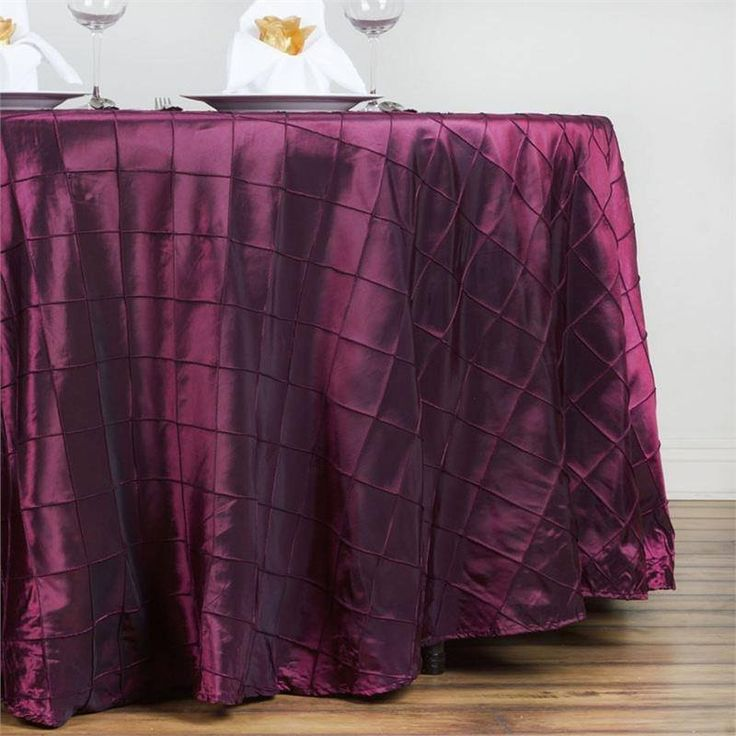 """Burgundy Pintuck Tablecloths 132"""" Round - Pintuck is actually a fold of fabric that is stitched intricately to hold it in a place, very much like a pleat. These lovely pleats impart a decorative effect to the fabric by fashioning a visual line at a chosen point. They effortlessly bridge vintage and contemporary styles to create a majestic new classic look. If you do not want your celebration to blend in with other weddings, birthdays, and anniversaries, try our premium quality pintuck…"""