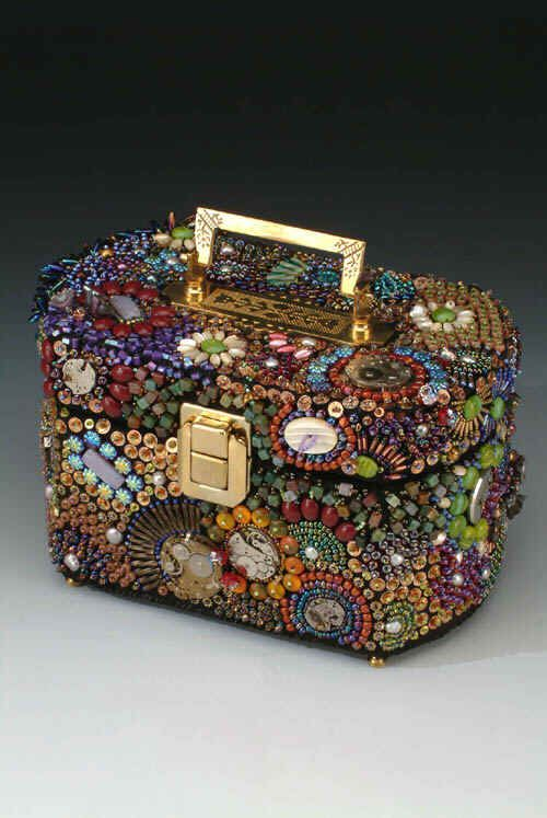 by Rebekah Hodous ~ 'Time' themed purse with vintage cabs, watch plates, vintage mother of pearl buttons, a wide variety of seed beads, sequins, various other beads, too numerous to name, brass feet, hinges, lock and a brass handle.
