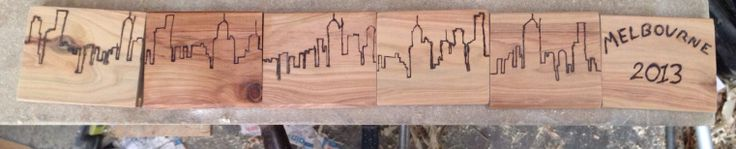 Melbourne skyline coasters. Made from reclaimed floorboards freehand etched.