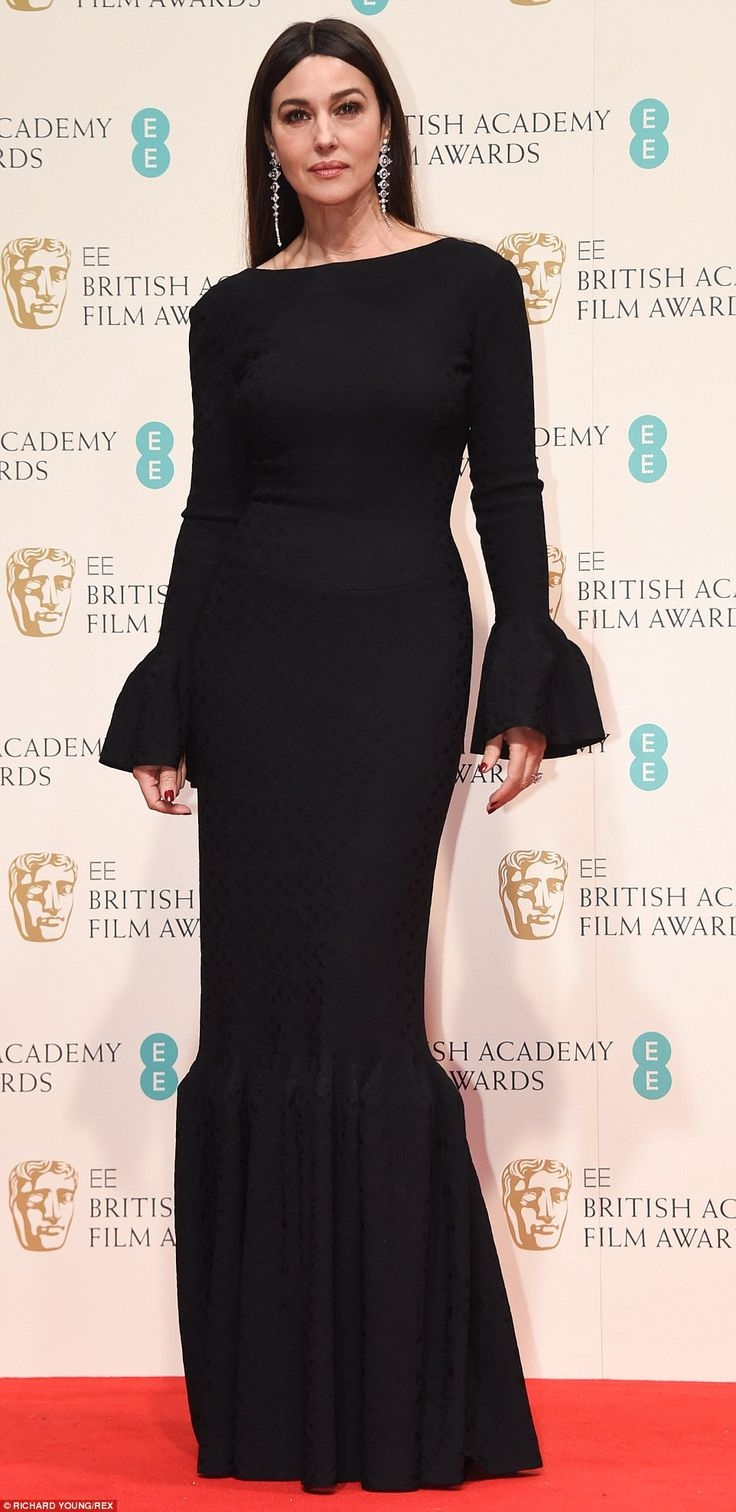Monica Bellucci's black gown was elegant but had a touch of Morticia Addams about it along...