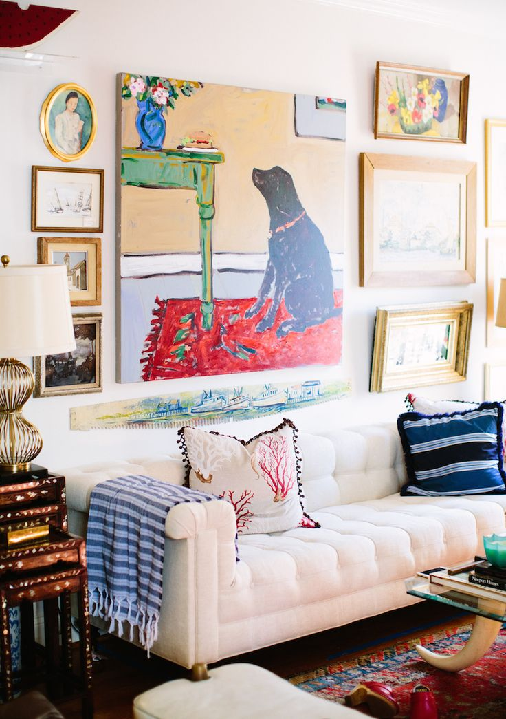 Love the eclectic mix of colorful art and textiles in this collected living room!
