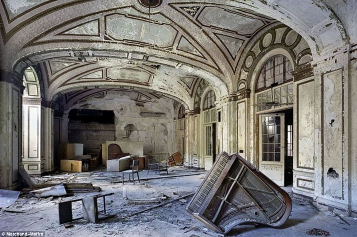 A forlorn note: Looking more like a war zone - or an underwater shot of the Titanic - the ballroom of the Lee Plaza Hotel and its upturned grand piano is a sorry sight    Read more: http://www.dailymail.co.uk/news/article-1370199/Detroit-Haunting-photos-crumbling-remains-highlight-decline-Motor-City.html#ixzz1kuLBVtAm