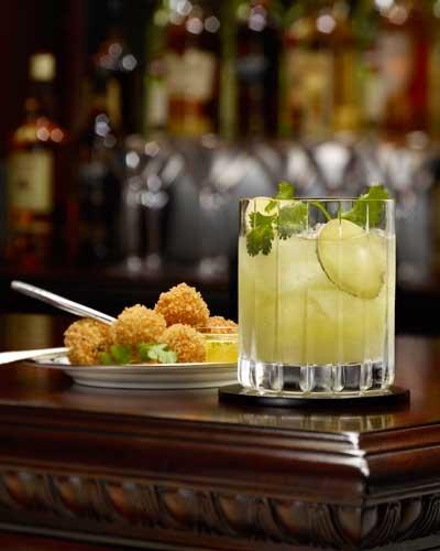 Sapphire & Sin. Gin, lemon juice, orange juice, ginger syrup.