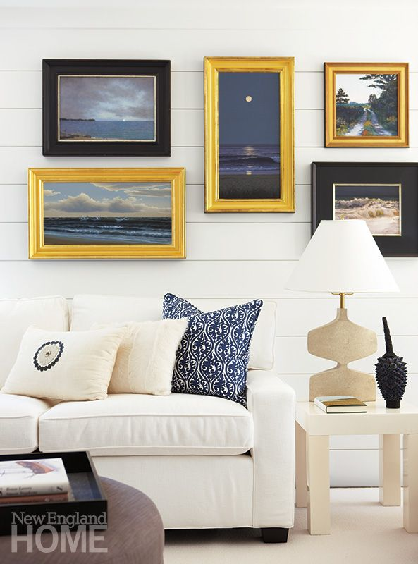 Ocean art gallery wall in a New England home.