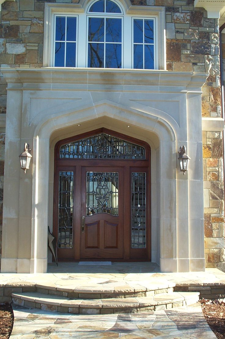 Cast Stone Surrounds Door Large Window Above Illuminates