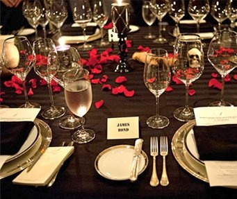 Elegant table setting from a James bond themed party. See more decor ideas for your own Bond themed event at www.sparklerparties.com/casino-royale