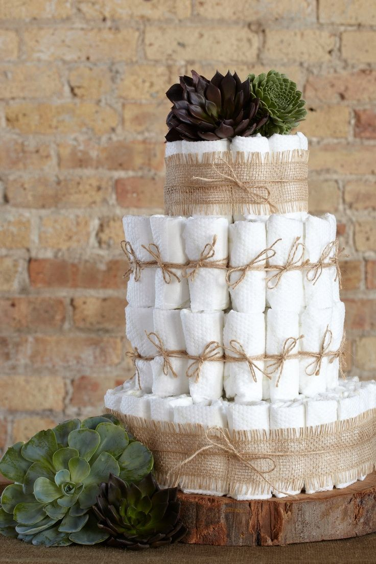 Going Green Diaper Cake. Create a four-tiered diaper cake with 100 HUGGIES® Pure & Natural Diapers, recycled paper ribbons and top with garden greenery.