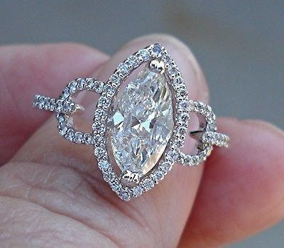 This is an awesome ring with lots and sparkle and fire!! The center marquise cut diamond is 1.14 ct. SI-2 clarity, G color. It is set into a 14K