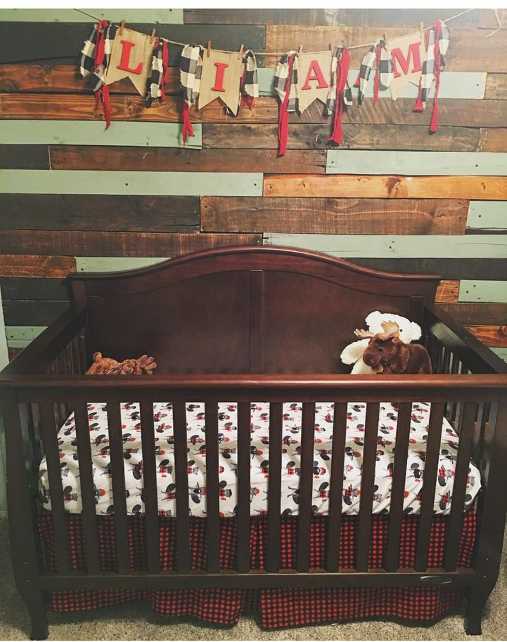 Lumberjack nursery with pallet wall, and homemade name banner.
