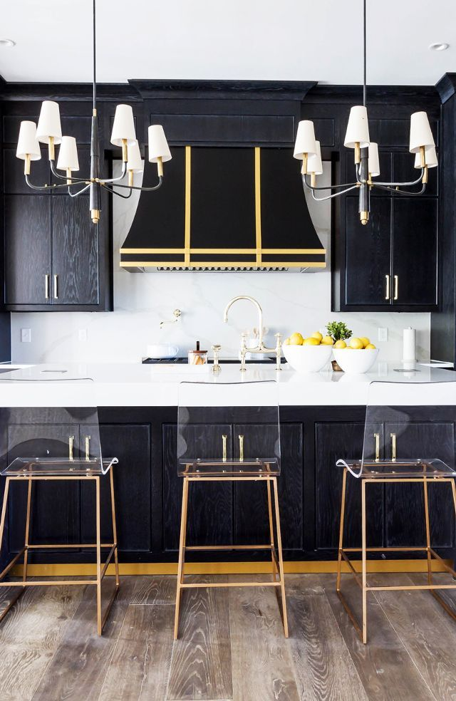One of the best parts of this kitchen is the fusion of old meets new. The chandeliers have a traditional feel, but when they're paired with clear perspex barstools, they suddenly feel fresh and...
