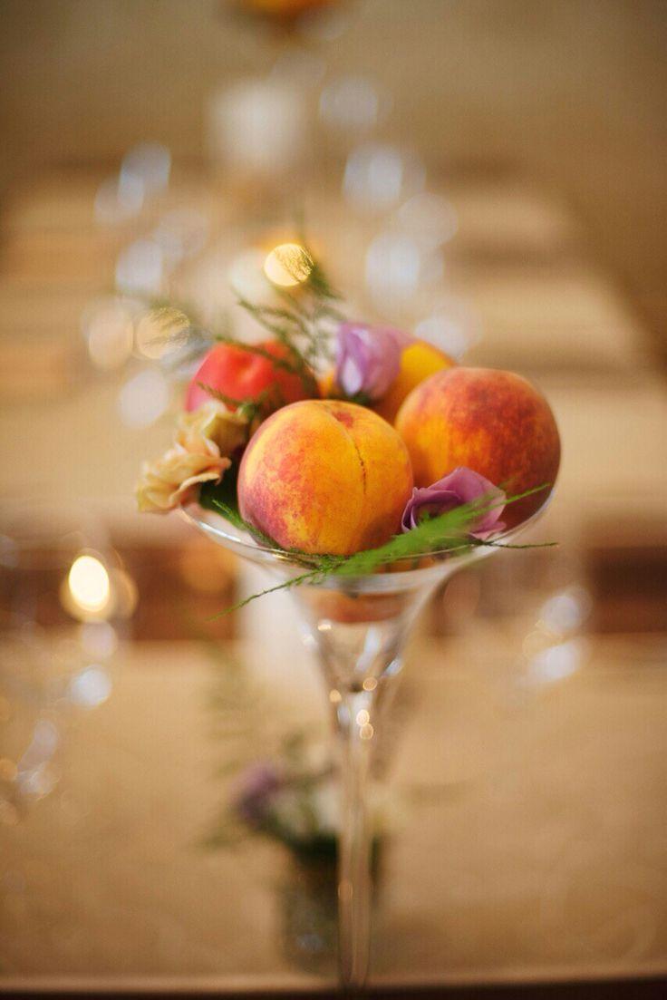 Peach and flowers in a martini glass .. A peach wedding designed by Danielle Design
