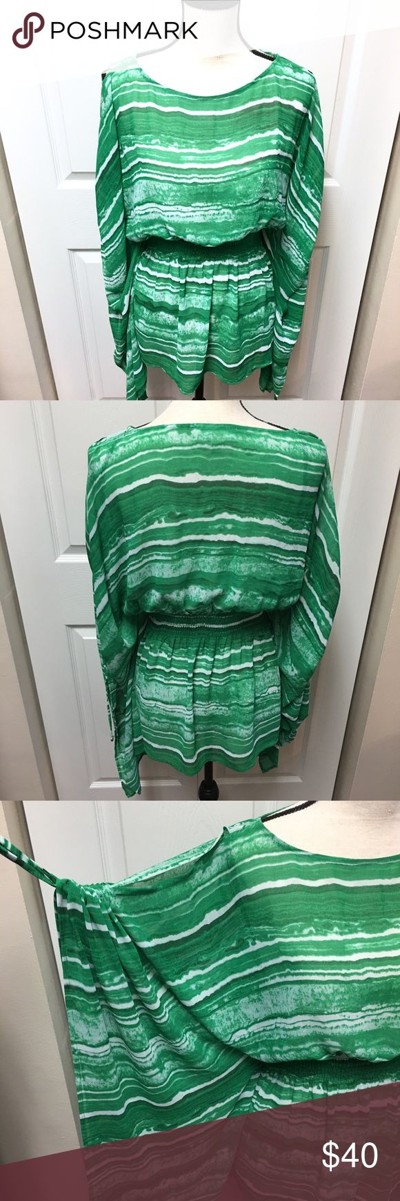 Authentic Michael Kors Sheer cold shoulder top Wear it as a holiday top or a bikini coverup in Miami. Such a versatile top. Like new! Cold shoulder with adjustable sleeves. Stretchy band around the waist. MICHAEL Michael Kors Tops Blouses
