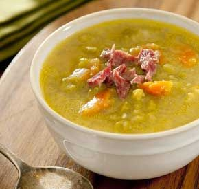 This split pea soup is hearty and made with veggies and ham hock. Super easy! Add all the ingredients to the slow cooker, cook for 6 hours on low, pull out the ham hock, shred and add back to the soup.