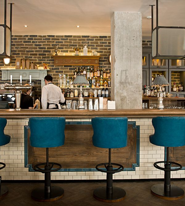 Love the pop of blue in the stools and in the trim at the bar front. Modern and whimsical