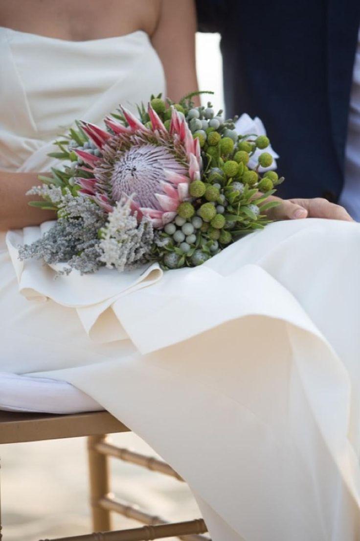 Giant Protea bouquet   Read More: http://www.stylemepretty.com/little-black-book-blog/2014/06/10/hong-kong-beach-wedding/   Planner: blisscreations.asia   Photography: Derek Ko  - derek-photography.com