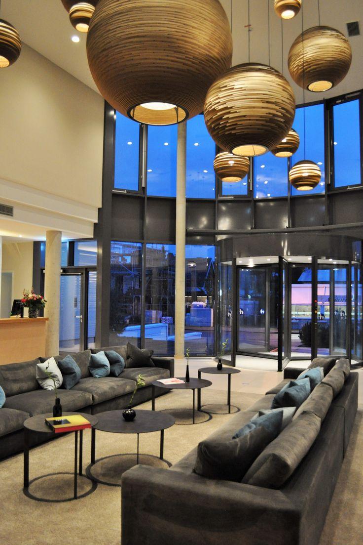 SeeHuus | Design Hotel | Germany | http://lifestylehotels.net/en/seehuus | lobby, design, modern, art, lamps, light, sofa, relaxing