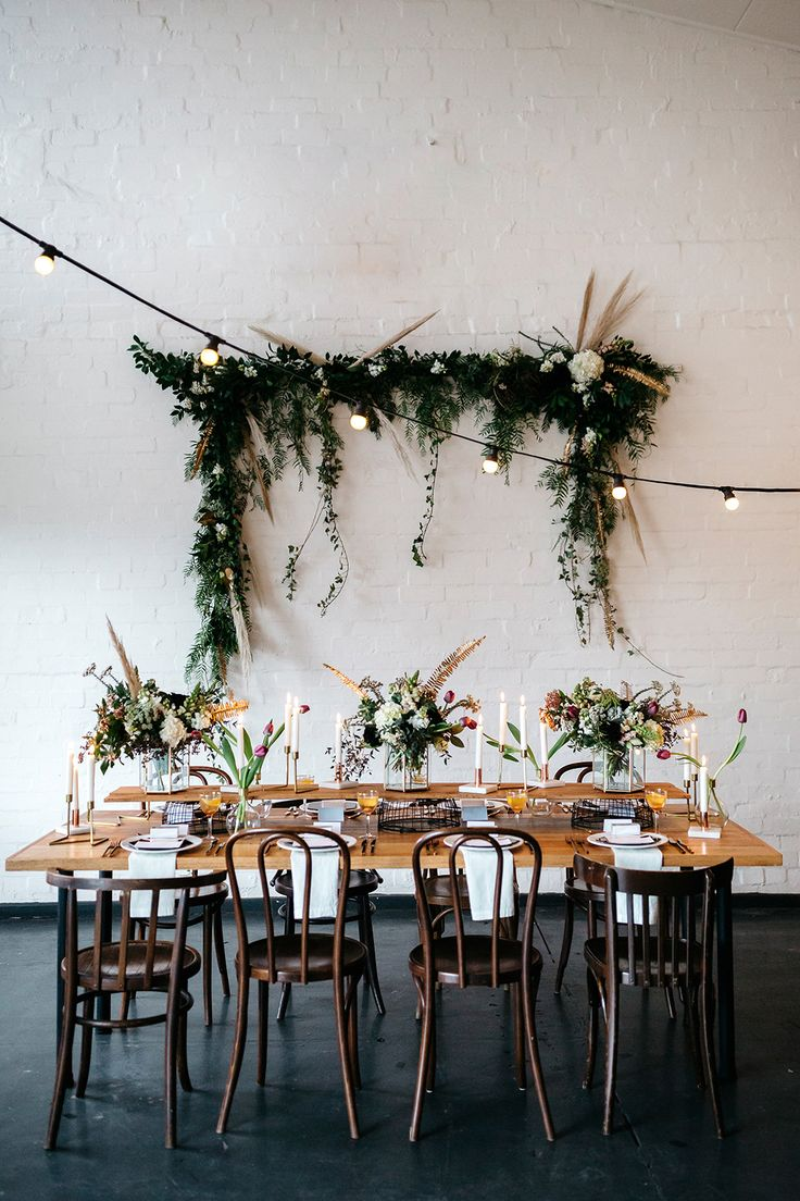 bistro lights - photo by Katie Harmsworth Photography http://ruffledblog.com/mixed-metals-wedding-inspiration