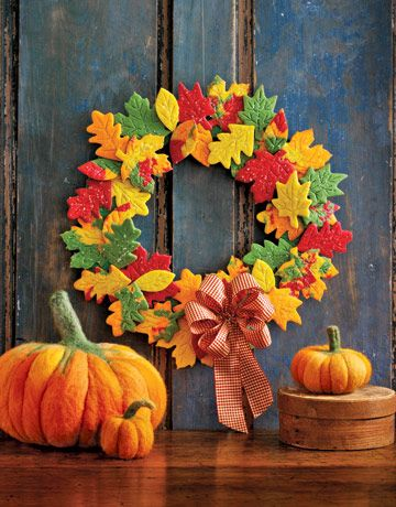 wreath made of fall colored leaf cookies and felt pumpkins. I love this. The cookies are fun to make and adhered with royal icing, so completely edible should a snacker be unable to resist. There are even instructions for making the felted wool pumpkins.
