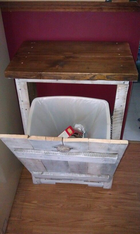 Trash can cabinet with white washed pallet boards and stained pine counter top