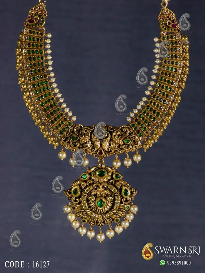 Antique nakshi haram with two stepped peacock pendants, the haaram adorned with Pearls and gold balls, Swarnsri Gold & Diamonds, Vijayawada. For any queries please whatsapp +91 9393891000, ☎️ 0866 - 2474133. #swarnsrigoldanddiamonds #https://swarnsri.blogspot.in/ #haaram #Nakshihaaram #goldjewellery #Antiquegoldjewellery #pinterest.com/swarnsri #goldchain #Peacockhaaram