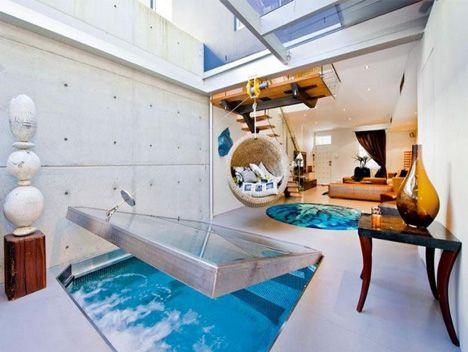 Indoor pools conjure images of giant rooms dedicated to swimming, or bathroom sauna-and-spa extensions … somehow, the concept of a small pool right in the middle of your living room seems impractical, but still strangely compelling.