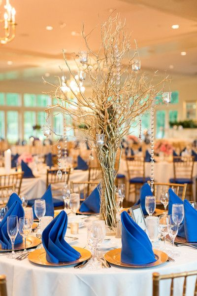 Glam wedding centerpiece idea - gold branches in glass vase with draped crystals {Candice Adelle Photography}